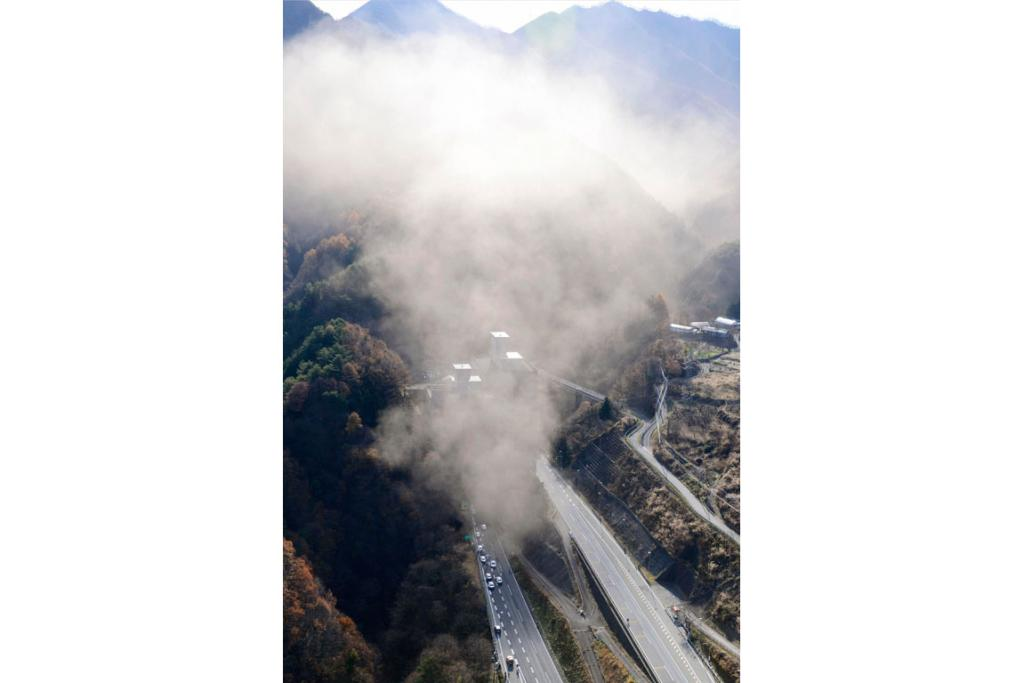 Smoke rises from the entrance to the Sasago Tunnel near Tokyo.