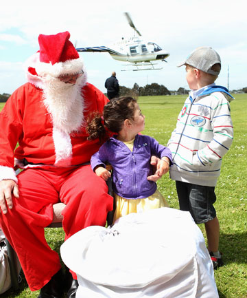 Poppy Robinson, 2, and Liam Ramsey, 6, with Santa