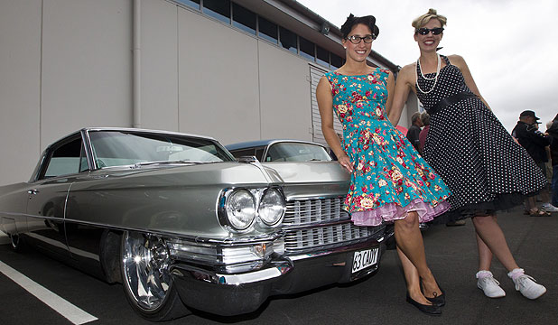 BACK IN TIME: Hayley Howlett, left, and Tracey Gilbert dressed for the occasion and arrived in style in a 1963 Cadillac.