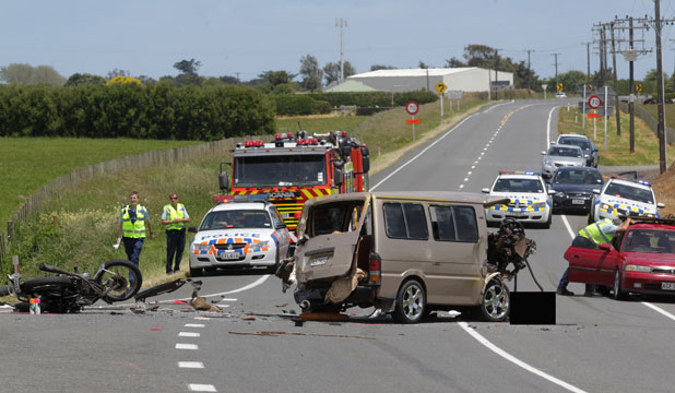 The scene on State Highway 3 after this van collided with a group of motorcyclists killing two of them.