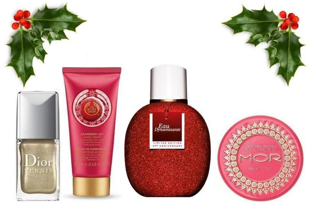 Dior Rouge Duo Vernis in Crocodile, $64; The Body Shop Cranberry Joy Hand Cream, $12;  Clarins Eau Dynamisante Limited Edition, $81; and MOR Lip Macaron in Rose, $14.99.