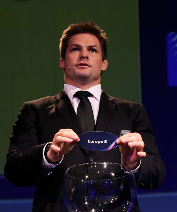 GOOD PICK: Richie McCaw helps draw the pools for the 2015 World Cup where the All Blacks will face Argentina, Tonga and two qualifiers in the early phase.