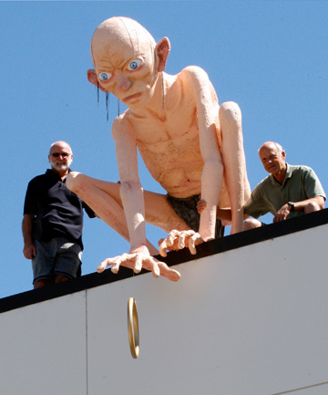 LARGER THAN LIFE: State Cinema Motueka manager Mark Wentworth, left, and Ruby Bay sculptor Derek Ball, right, on top of the cinema with the Gollum Mr Ball made to promote The Hobbit.