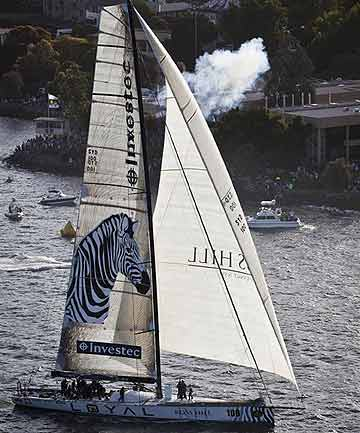 Investec Loyal of Australia crosses the finish line to win the annual Sydney to Hobart yacht race.