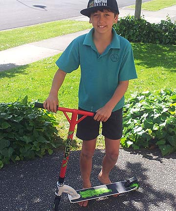 STOKED: Cody Oakes enjoys his scooter that was pilfered and, after a leaflet drop, mysteriously returned. ''Cody said to me that he'd like to think that the person regreted taking it and bought it back,'' his mother Leah Oakes says.