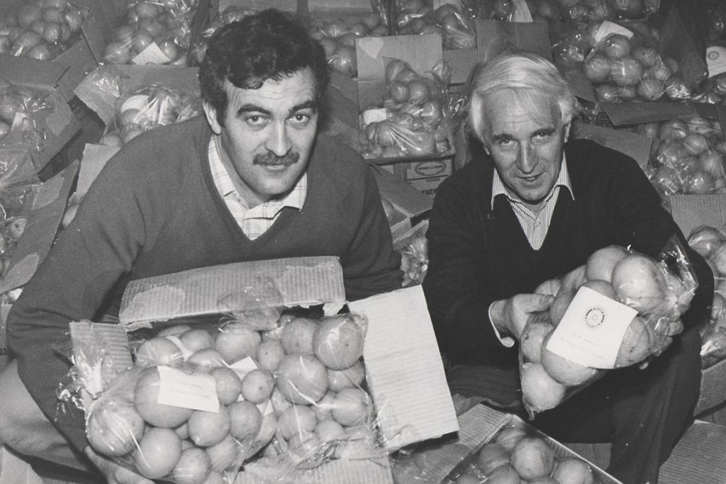 """SPUD BONANZA: These men have a bumper crop of potatoes, but what are they going to do with them?   Ex-Rotarian Barrie Wood supplied a wealth of information about this mystery photo which shows members of the Rotary Club of Timaru. """"Many people will recognise the two Rotarians, Colin Taylor and Gary Pollock, helping with the winter health project of distributing fresh grapefruit and oranges donated by a North Island club to help boost the health of the elderly in our area,"""" he wrote. """"A great example of helping our own community."""" Keith Bartholomew, club historian, said the approximate date of this photo was June 1987, a time when Mr Pollock was chairman of the club's Community Service Committee and Mr Taylor was club president."""