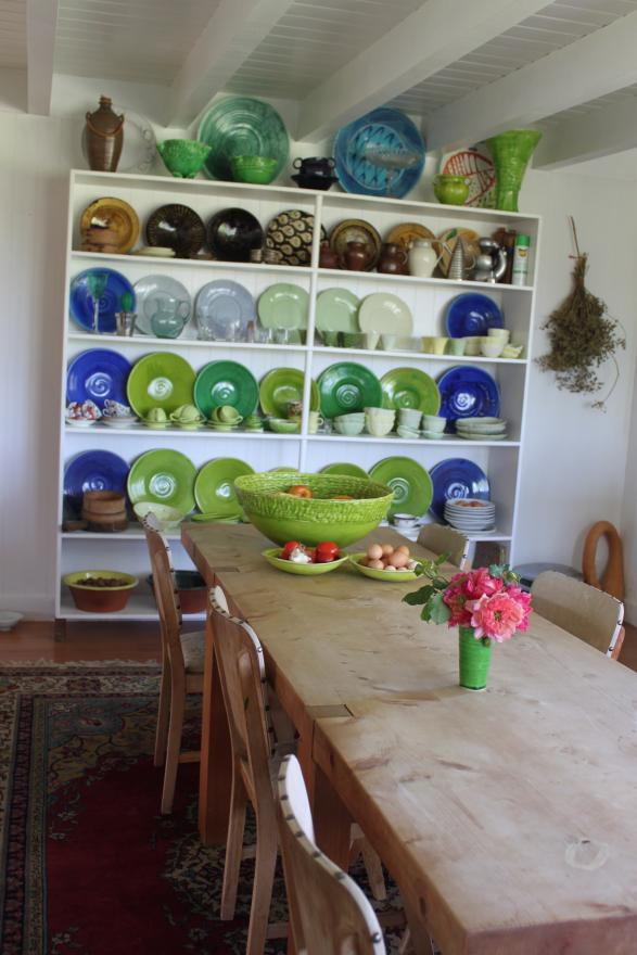 Everyday crockery crafted by Christine makes a colourful backdrop to the dining area.