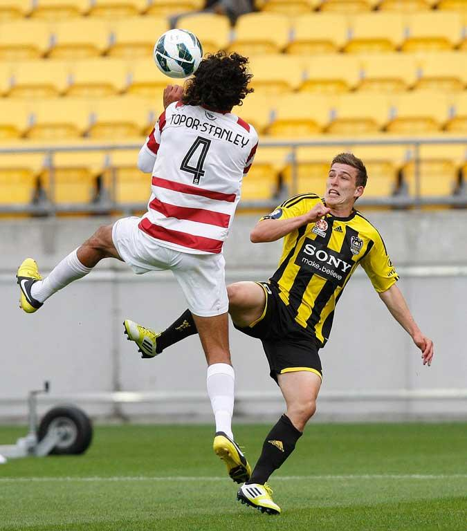 Louis Fenton of the Phoenix and Nikolai Topor-Stanley of the Wanderers in action.