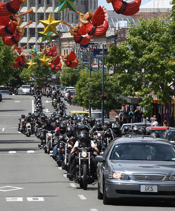 FUNERAL: A motorcycle procession heads up Stafford St for Road Knight Grant Roberts.