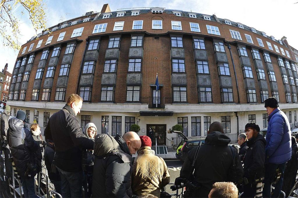 Members of the media wait outside the King Edward VII hospital in London.