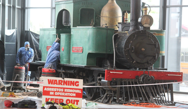 Specialist in protective gear work on the Otago Settlers Museum engine Josephine.