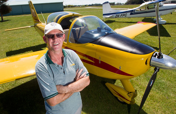 ADDICTED TO ADVENTURE: Manawatu Districts Aero Club flying director David Cameron at  Taonui Aerodrome, Feilding, stands by a Tecnam Sierra plane.