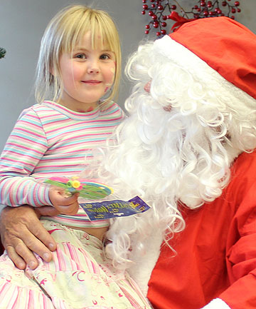 CHRISTMAS WISHES: Hannah Thompson, 4, gets her moment with Santa.
