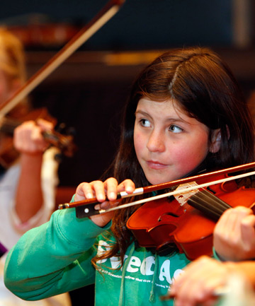 MAGIC: Maya Speers, 11, of Nelson, playing the violin during the Top of the South Nelson Youth Orchestra rehearsal.