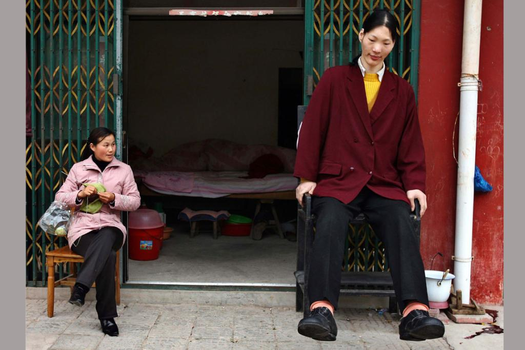 AT PEACE: The world's tallest woman, measuring 2.33m, Yao Defen dies.