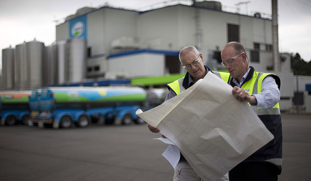 CHECKING IT OUT: Fonterra Pahiatua process manager Brian Hutchins and site operations manager Bill Boakes look over plans at the site.