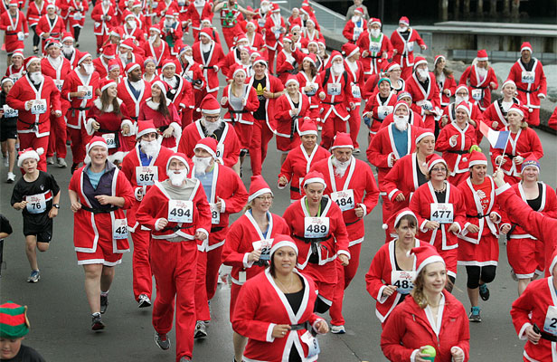 ON THE RUN: Hundreds of people dressed as Santa Claus make their way along the Wellington waterfront.