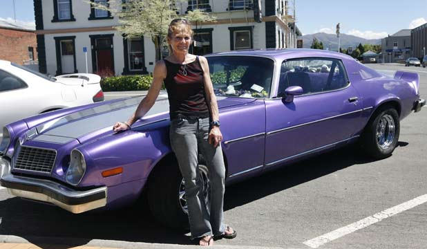"A CLASSIC: Lynn Bysterveld, pictured in Waimate, drives a 1974 Chevrolet Camaro which she has owned for 13 years saying: ""I've always been into classic cars; I just like the rumble and they are easy to work with."""