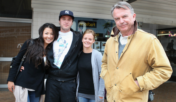 Actor Sam Neill (right) in Esk St this afternoon with (from left) daughter Maiko Spencer, son Tim Harrow and his son's fiance Lisa Hughes.