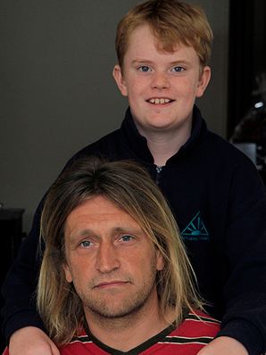 RELUCTANT SAVIOUR: Aidan Clark, 11, of Nelson, who was caught in a tidal rip near  Parker's Cove, last Sunday, with his rescuer Toomas Krivonogov.