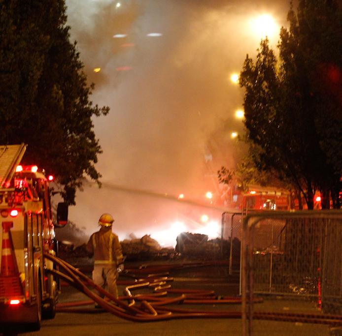 WATCHFUL: A firefighter near the scene of a large fire in central Christchurch.