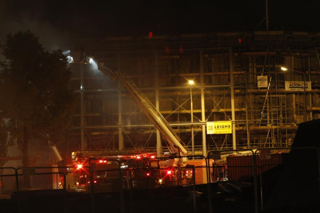 Firefighters work to contain the blaze on the corner of High St and Tuam St, near the McKenzie & Willis site.