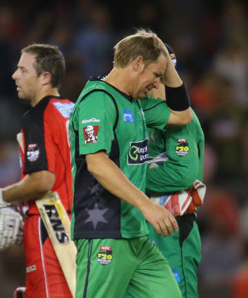 OFF NIGHT: Shane Warne scratches his head as he fails to make an impact for the Stars.