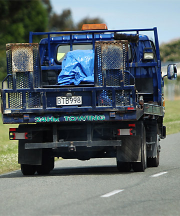 REMOVAL: A tow truck leaves the Timaru International Motor Raceway with a covered bike after a rider was killed on the track.