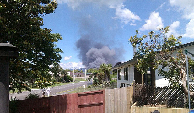 BIG SMOKE: The explosion is seen from the end of Park Road, Katikati.