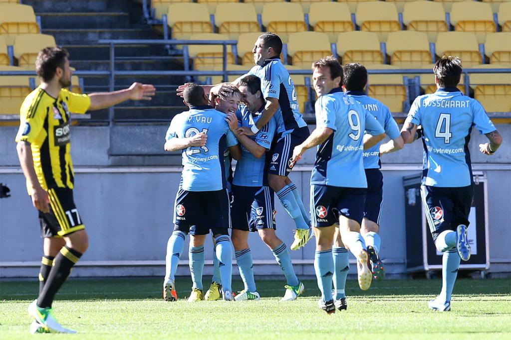 Sydney FC celebrate scoring against the Phoenix.