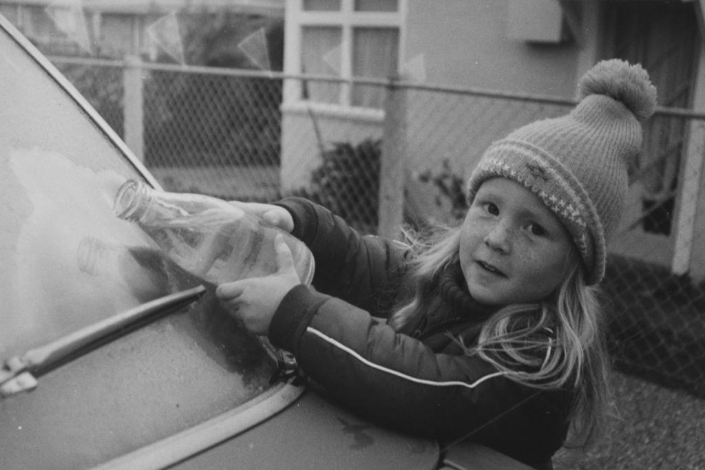 """FROSTY MORNING: This little girl appears to be giving someone a hand defrosting a car window.   UPDATE [08/12/2012]: Heather Leary identified this girl as Heidi Leary, who lived in Oxford St back in the early 1980s before shifting to Oamaru. ''The photo was taken on a very cold frosty morning,'' Heather wrote. """"She now lives in Melbourne and is a senior consultant with Certus Solutions."""""""