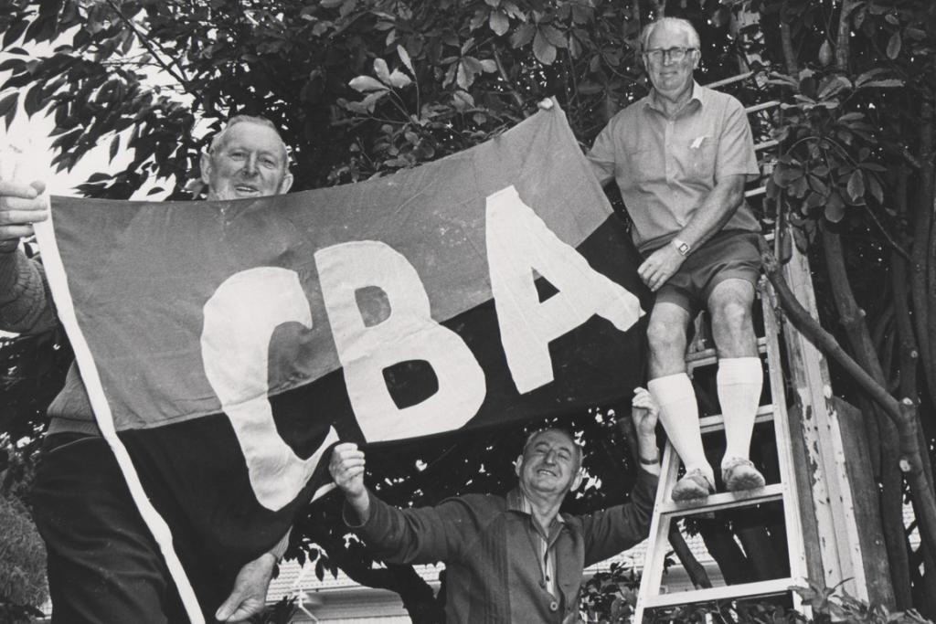 """FLAG BEARERS: Who are these men and what is their association with the CBA?  UPDATE [08/12/2012]: Commenter Rachael Comer identified these men as, from left, Ian Green, Ted Davidson and Bob McConnochie. """"Bob was my grandfather and both Ian and Bob were presidents and life members of the Caroline Bay Association,'' she wrote. ''I think Ted was a life member but not sure if he was ever a president. The flag was always raised on Boxing Day at 11am to open the carnival for another year."""""""