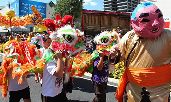 DRAGON DANCE: Members of Hamilton's Chinese Community danced down the street with dragons and lions.