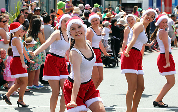 ON TAP: A group of Santa-esque dancers take the lead, kicking off the parade in style.