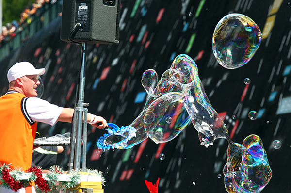 MONKEY MIX: The Funky Monkeys create giant bubbles for the kids on the way past.