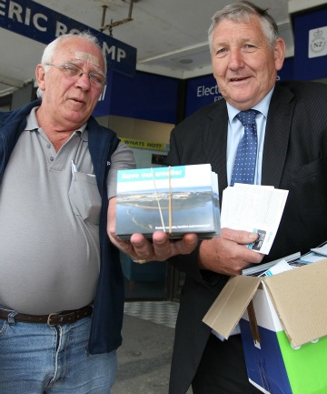 EMPU Southland organiser Trevor Hobbs of the Save Tiwai Aluminium Smelter postcard campaign, left, presenting them to National MP Eric Roy at his Invercargill office.