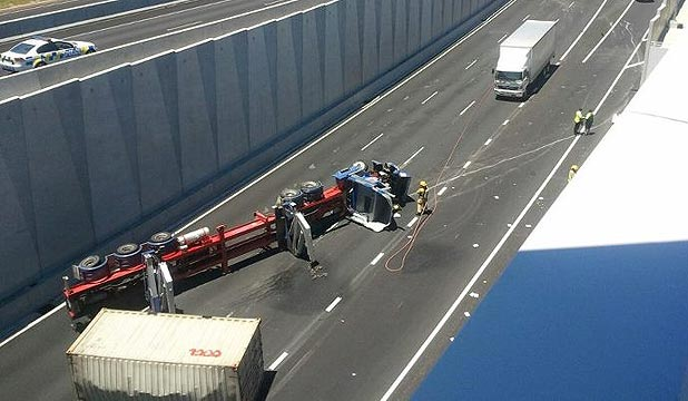 BLOCKED: A toppled truck blocks all three lanes of the Victoria Park Tunnel entrance.