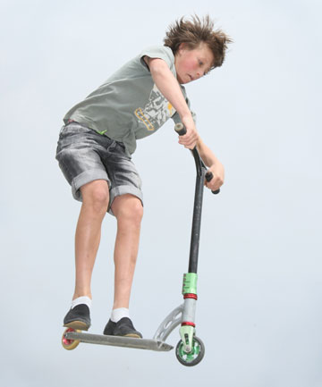 HIGH FLYER: Jayden Pearsey, 12, jumps on his scooter at the Elles Rd skatepark.