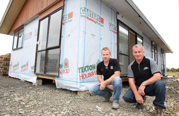 MOVING HOUSE: Bill McNamara and his son, Jade, owners of Transit Homes Ltd, with the house they are taking to this weekend's Invercargill Christmas Races.