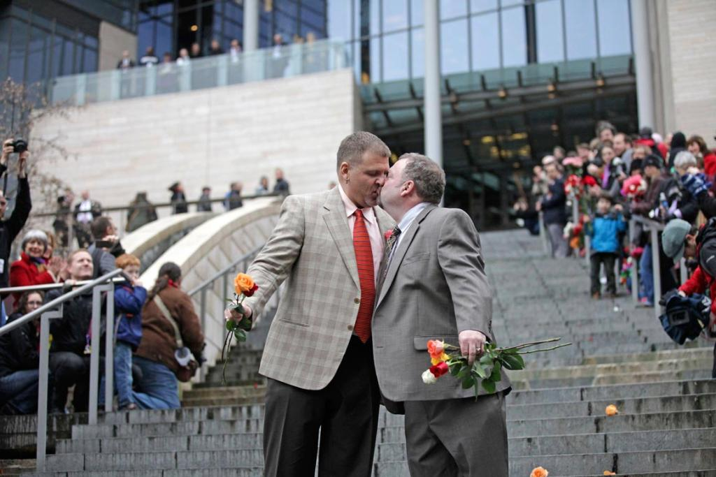 DECEMBER 11: Brad and Jay McCanta kiss to a cheering crowd on the steps of Seattle City Hall in Washington. Washington made history last month as one of three US states where marriage rights were extended to same-sex couples by popular vote, joining Maryland and Maine in passing ballot initiatives recognizing gay nuptials