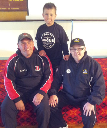 Good shot: David, left, and Angus Little with Cricket Wellington Umpires' chairman Grant McAlister.  Umpires and scorers donated their match fees for a day, raising $1240 for the Angus Little Brain Tumour Fund Raising Appeal.
