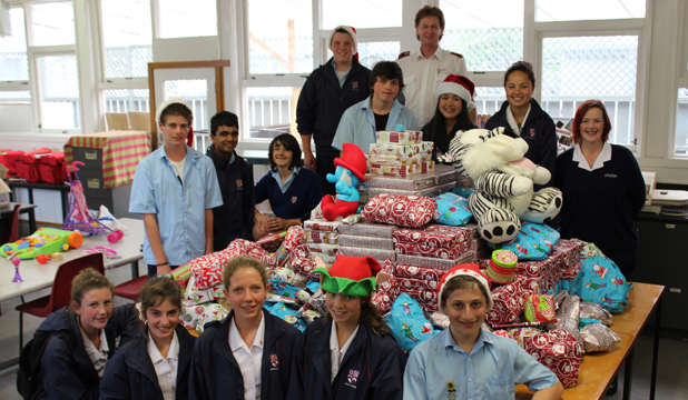 TOY TOWER: The Rosehill College junior council has collected around 400 toys. They're pictured with Salvation Army officers Steve and Nicki Dutton.