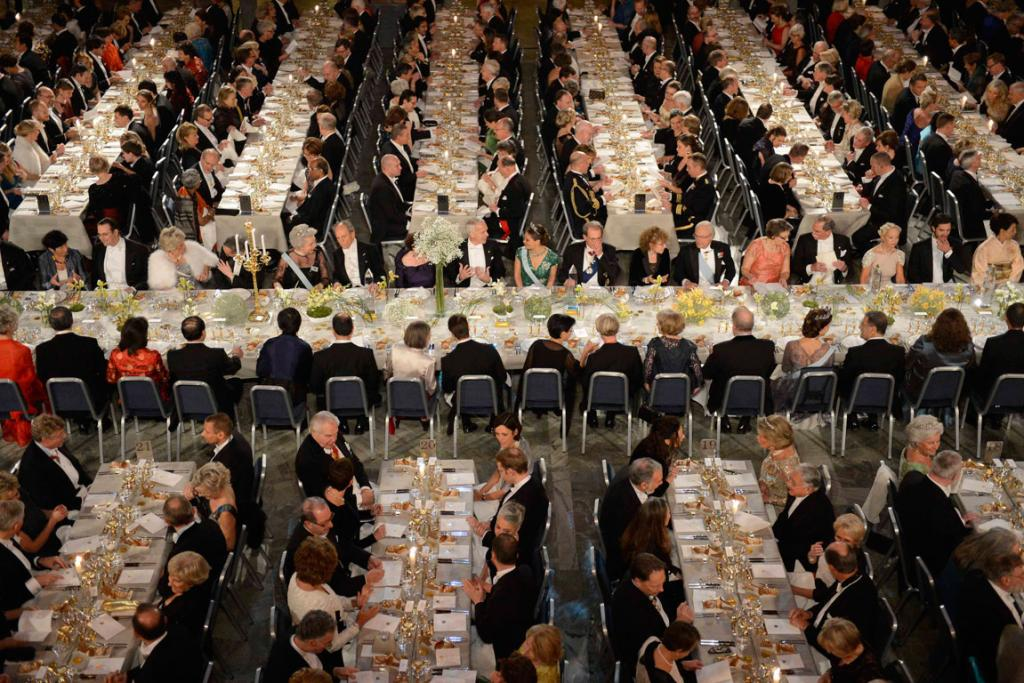DECEMBER 12: Nobel laureates and guests are seated in the Blue Hall in Stockholm attending this year's Nobel Banquet.