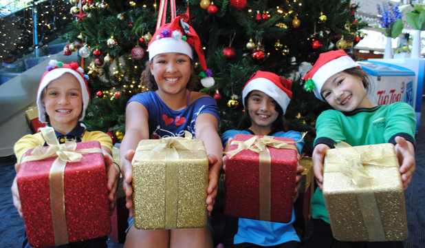 CHRISTMAS FUN: In front of the Tree of Hope are, from left: Katja Boonzaier, 10, Lily Hamilton, 9, Mya Mobberley, 10, and Beatrice Harris, 8, who will perform in the Bruce Mason Centre's annual Christmas show.