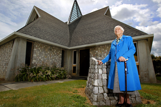 Ailsa Carpenter, 100, stands outside Saint Andrews Church, Blenheim. Ailsa grew up in Blenheim and has come back for a holiday.