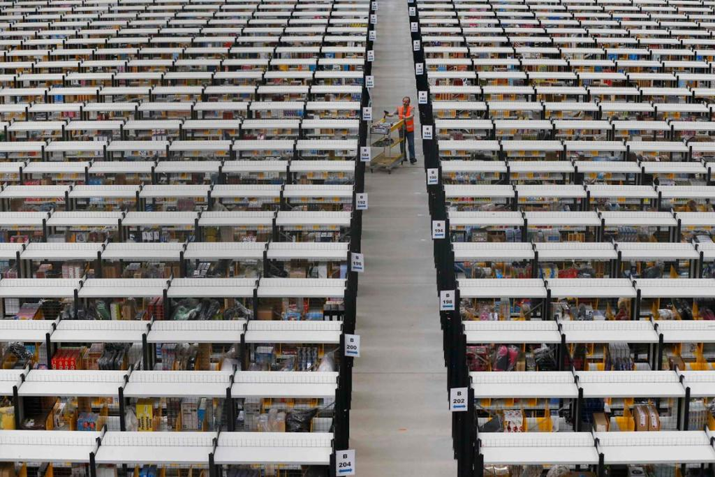 DECEMBER 13: A worker collects orders at Amazon's fulfilment centre in Rugeley, central England