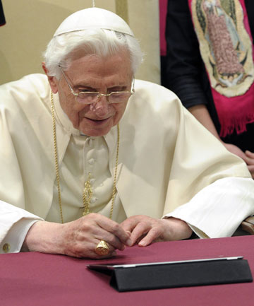 Pope Benedict XVI posts his first tweet using an iPad tablet.