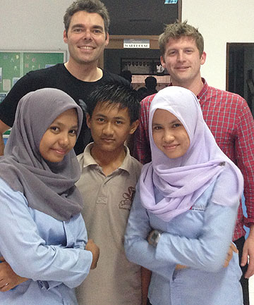 CULTURAL EXCHANGE: Justin Brown, back left, with Darragh Brennan and some of the students from Perawang learning centre in Indonesia.