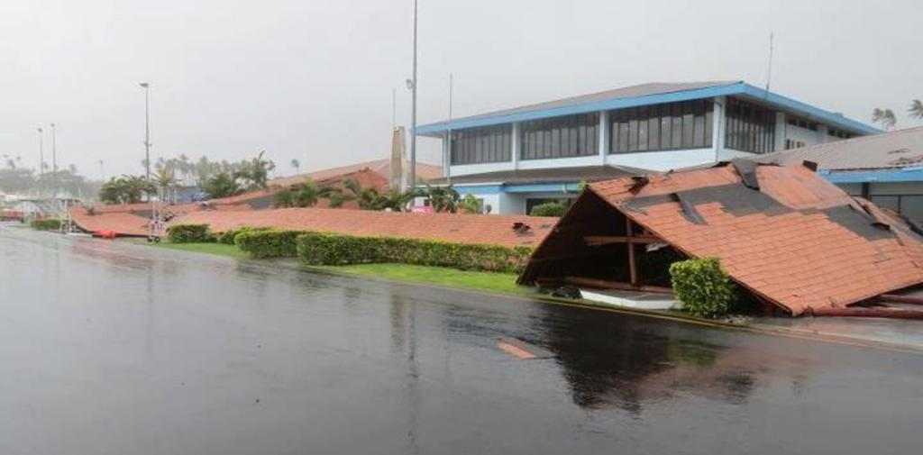 A walkway at the airport in Apia collapsed as Cyclone Evan started pounding Samoa.