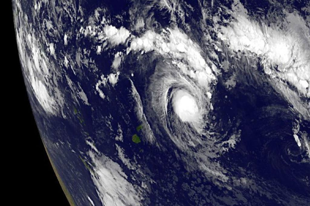Cyclone Evan is seen forming in this NASA handout image.